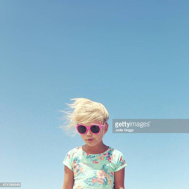 Portrait of child outside wearing sun glasses