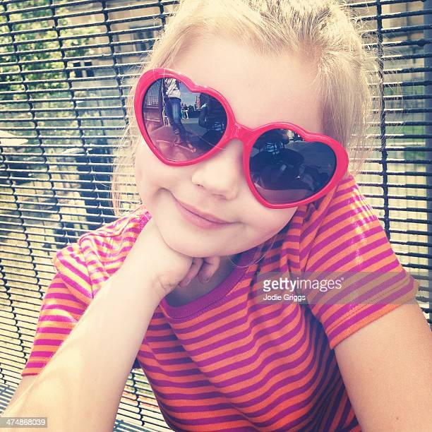 Portrait of child wearing heart shaped glasses