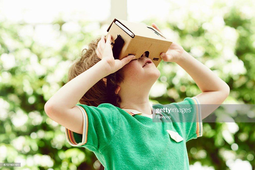 Portrait of child wearing  virtual reality headset : Stock Photo