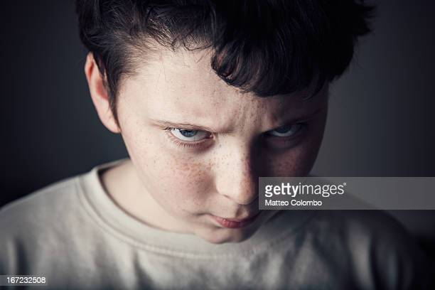 portrait of child with angry expression - furious stock pictures, royalty-free photos & images