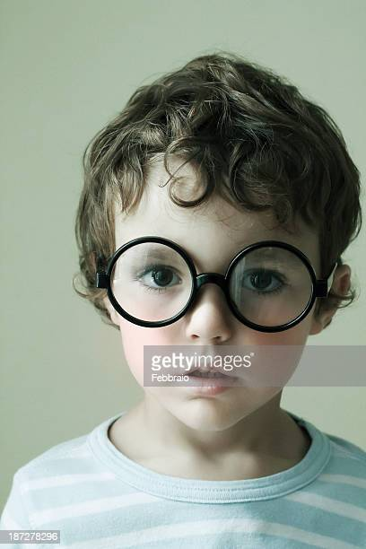 Portrait of child with big round glasses