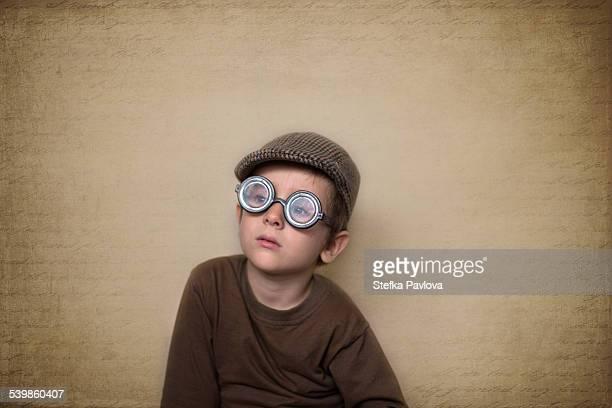 Portrait of child with big round glasses