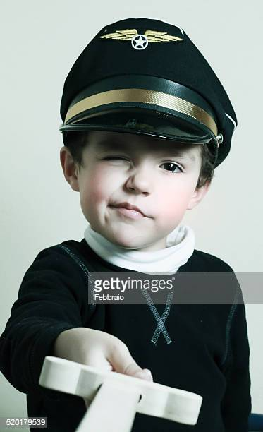 Portrait of child with pilot hat and sword