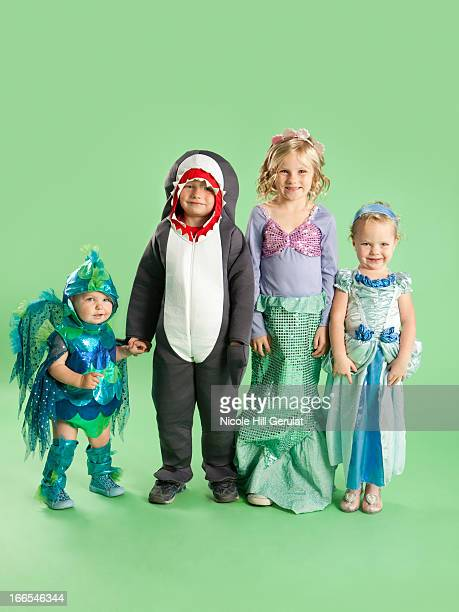 Portrait of children (12-17 months) and (2-7) in Mermaid and fish costumes for Halloween