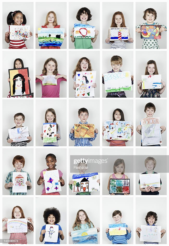 Portrait of children holding their art work : Stock Photo