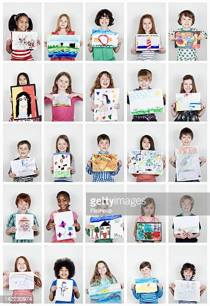 Portrait of children holding their art work