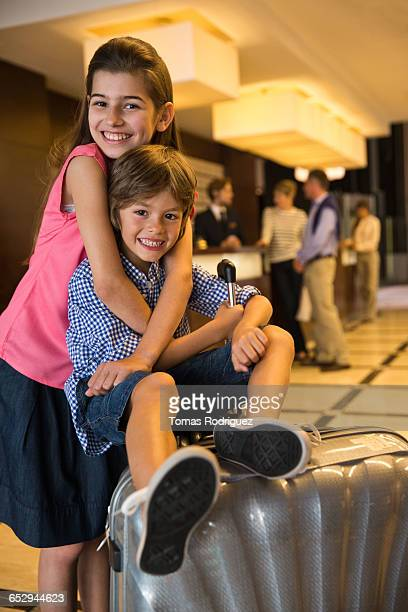 Portrait of children playing in hotel lobby.