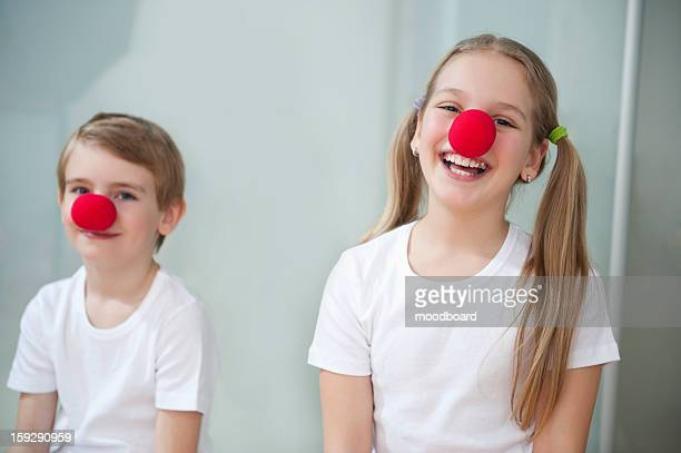 portrait of children wearing clown noses - clown's nose stock photos and pictures