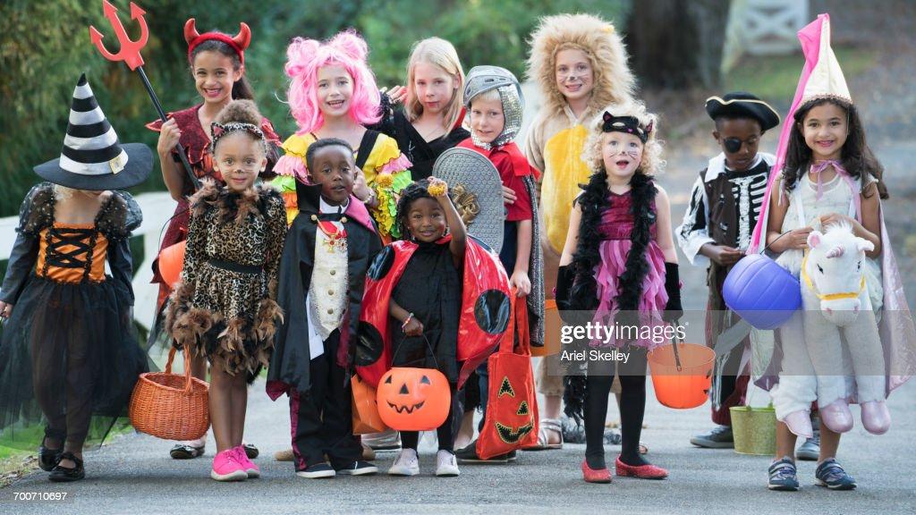 Portrait of children wearing costumes on Halloween : Stock Photo