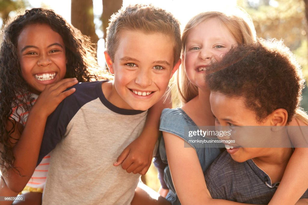 Portrait Of Children With Friends On Hiking Adventure In Woods : Stock Photo