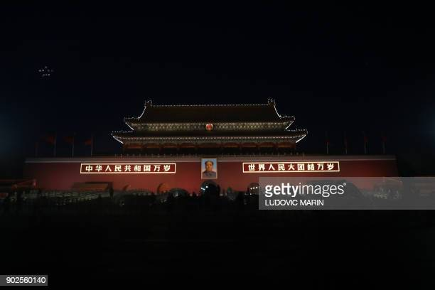 Portrait of China's late communist leader Mao Zedong is displayed at the main entrance to the Forbidden City in Tiananmen Square in Beijing on...