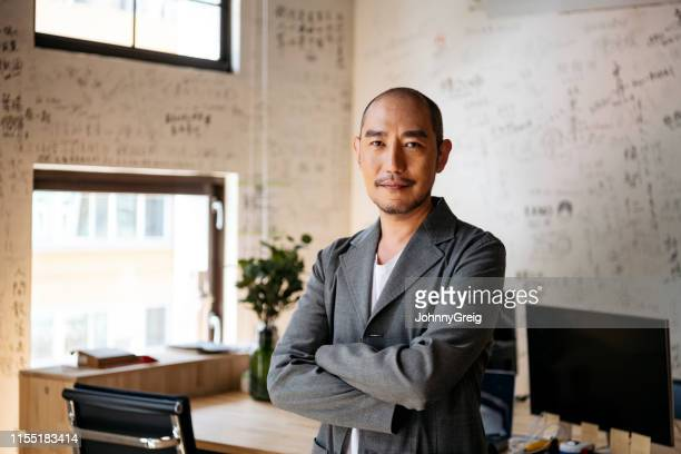 portrait of chinese businessman in creative office - smart casual stock pictures, royalty-free photos & images
