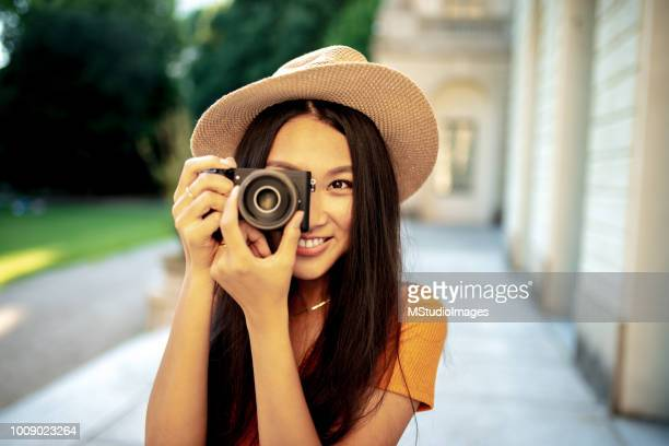 Portrait of Chinese woman making a photo.