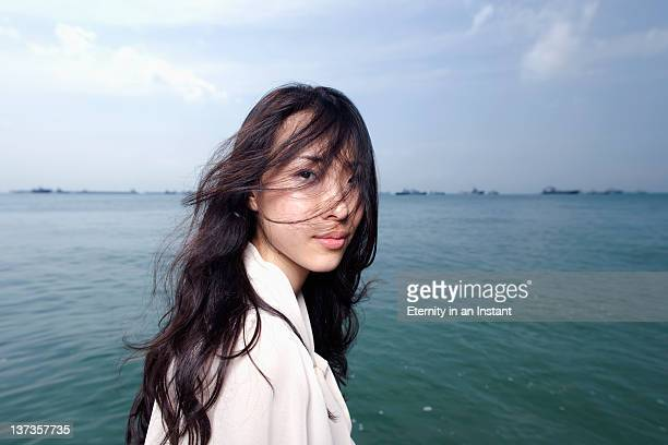 Portrait of chinese woman with windswept hair