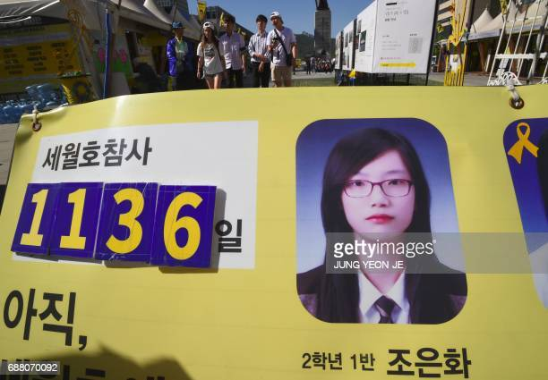 A portrait of Cho EunHwa one of four students who went missing in the 2014 South Korea's Sewol ferry disaster is seen on a notice board near a...