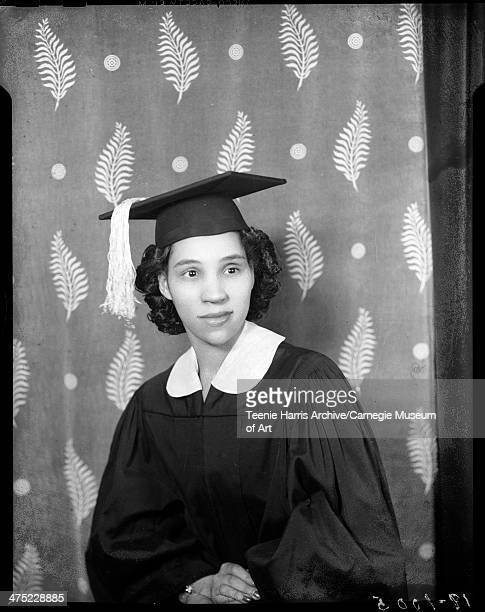 Portrait of Christine Smith wearing dark graduation gown with light colored collar and mortar board posed in Harris Studio Pittsburgh Pennsylvania...