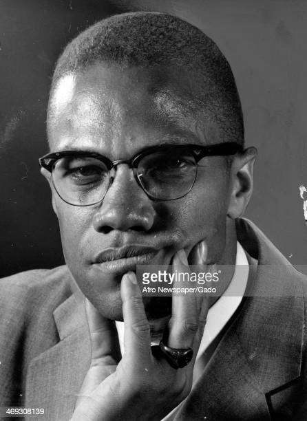Portrait of civil rights leader Malcolm X, his hand on his chin, circa 1965.