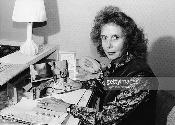 Portrait of Clara Calvi who holds a photograph of her husband murdered Italian banker Roberto Calvi ealy 1980s She campaigned ultimately successfully...