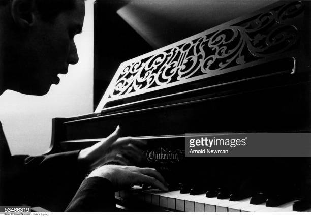 Portrait of classical musician Glenn Gould playing his piano November 28, 1963 in Toronto, Canada.