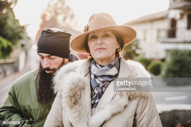 Portrait of Classy Mature Woman and Street Style Adult Man