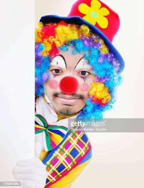 Portrait Of Clown Against White Background