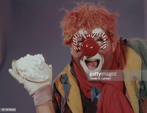 Portrait Of Clown Holding Pie