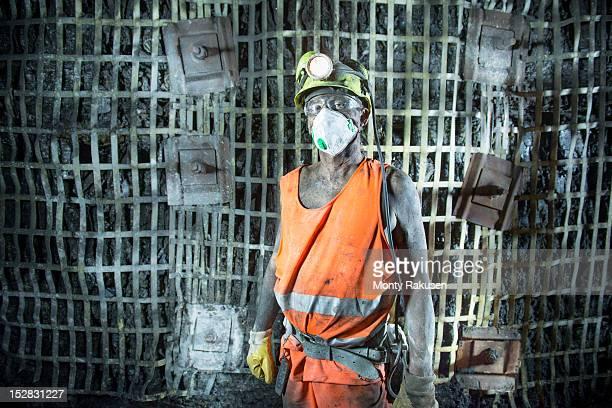 Portrait of coalminer working in deep mine