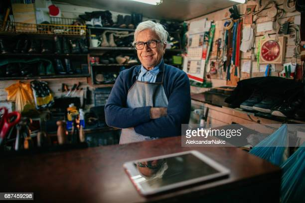 portrait of cobbler - shoemaker stock photos and pictures