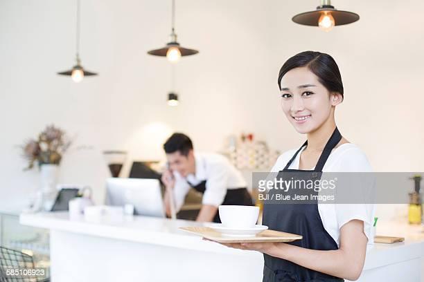 Portrait of coffee shop waitress