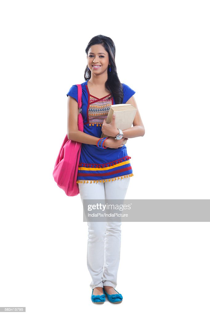 Portrait of college girl with book smiling : Stock Photo