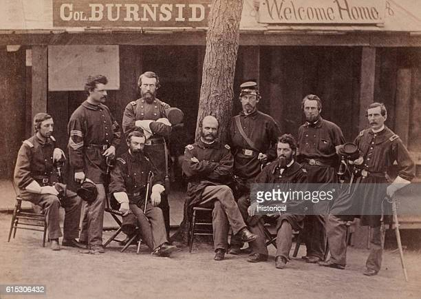 Portrait of Colonel Ambrose Burnside and his staff while he commanded the 1st Rhode Island Infantry Regiment in 1861 From left to right are paymaster...