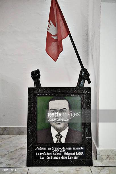 A portrait of Colonel Mohamed Bacar the selfproclaimed leader of the Indian Ocean island of Anjouan decorated with an Anjouanese flag is pictured in...