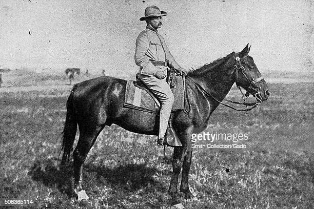 Portrait of Colonel Theodore Roosevelt on a horse in a field 1898
