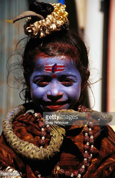 Portrait of colourfully decorated girl.