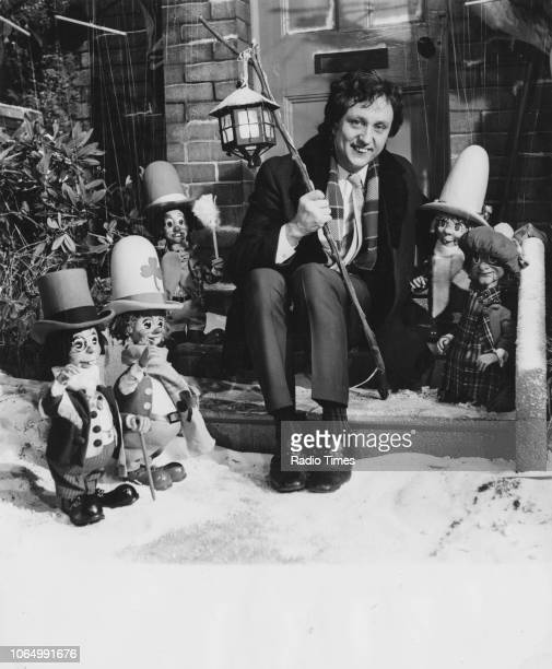 Portrait of comedian Ken Dodd and with a group of wooden puppets called 'the Diddy Men', November 6th 1969.