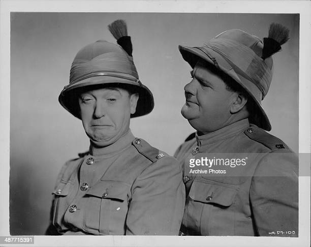Portrait of comedic actors Stan Laurel and Oliver Hardy in costume as they appear in the movie 'Bonnie Scotland' 1935