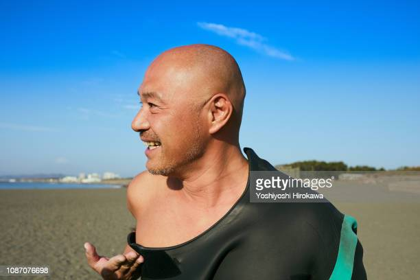 Portrait of company president in holiday on beach at morning.