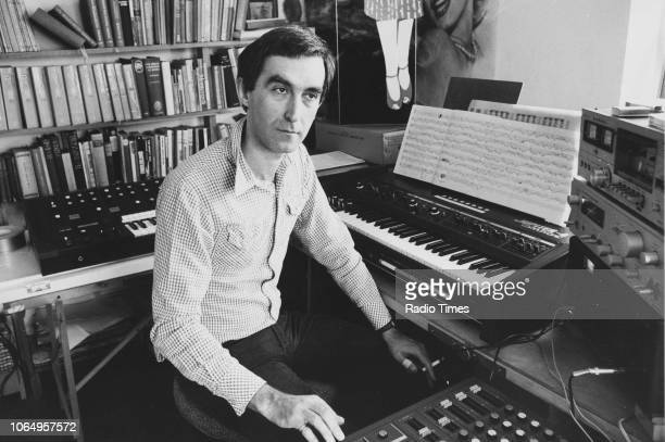 Portrait of composer Giles Swayne in front of a keyboard and sound equipment April 16th 1981