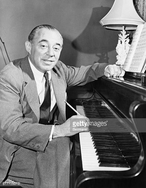 A portrait of composer Richard Rodgers sits at his piano creating a musical score for the forthcoming NBC television series Victory at Sea This will...