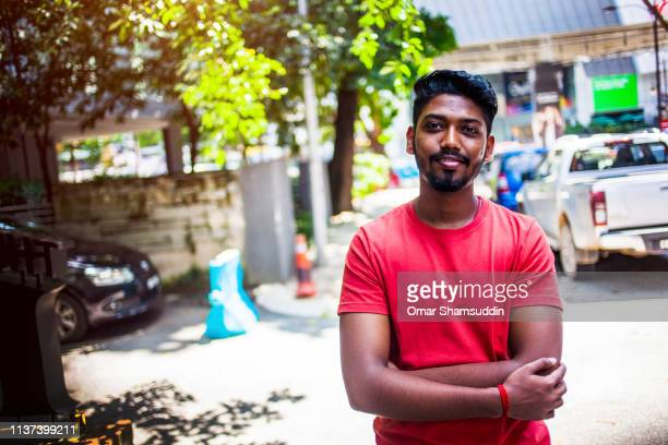 portrait of confidence asian man on the street of kuala lumpur - omar shamsuddin stock pictures, royalty-free photos & images
