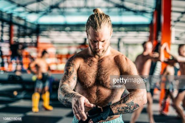 portrait of confident adult man doing mma and kick boxing - hairy asian stock pictures, royalty-free photos & images