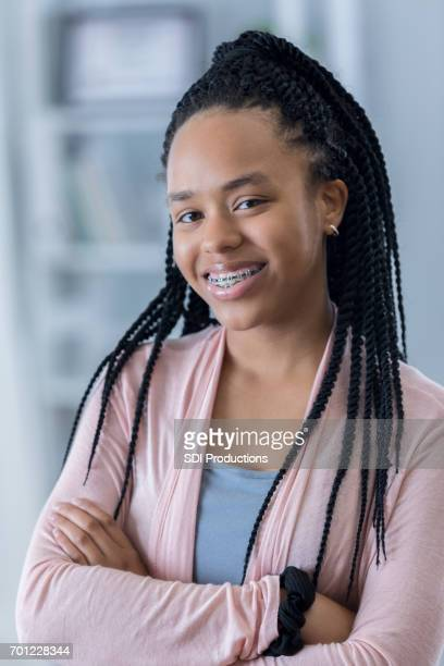 portrait of confident african american teenager - beautiful girl smile braces vertical stock photos and pictures