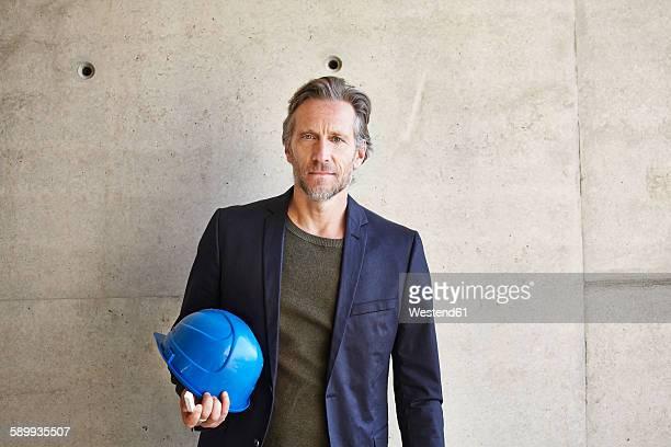 Portrait of confident architect on construction site