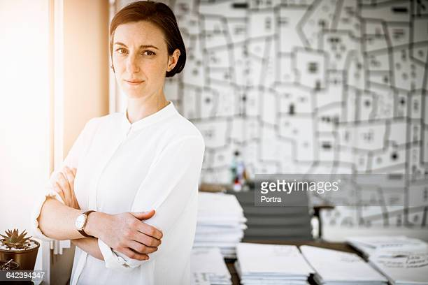 portrait of confident architect standing in office - bluse stock-fotos und bilder