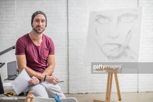 portrait of confident artist with drawing in studio - pencil drawing stock pictures, royalty-free photos & images