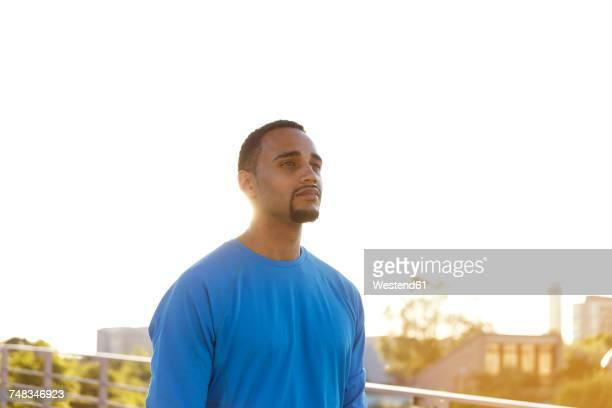 Portrait of confident athlete in the city
