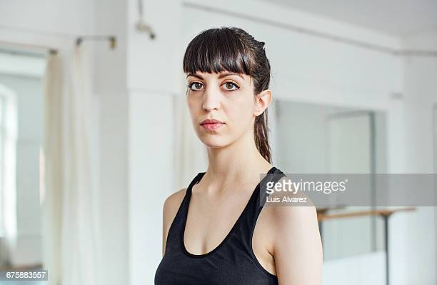 Portrait of confident ballet dancer in studio