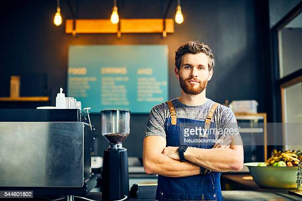 Portrait of confident barista in cafe