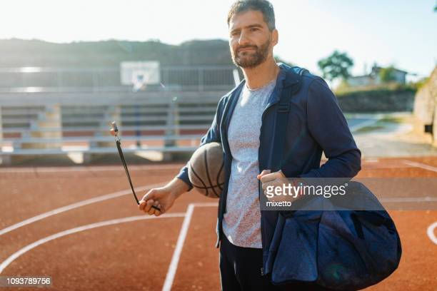 portrait of confident basketball coach - whistle stock pictures, royalty-free photos & images