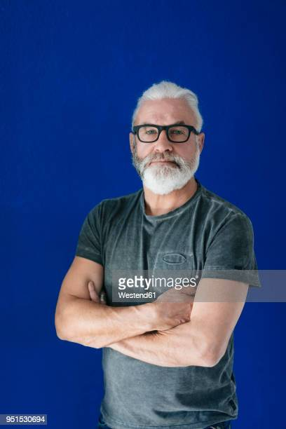 portrait of confident bearded mature man - one mature man only stock pictures, royalty-free photos & images